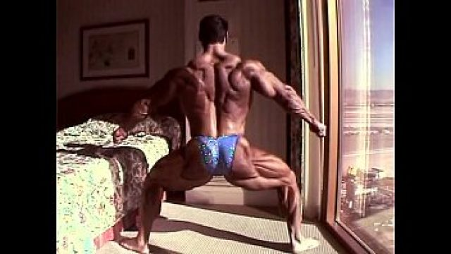 Muscle Gay advantaged in hotel bedroom 3